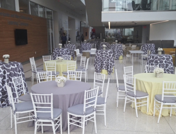 table settings with purple and yellow linens
