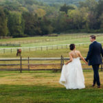Bride and groom on the grounds of Radnor Hunt