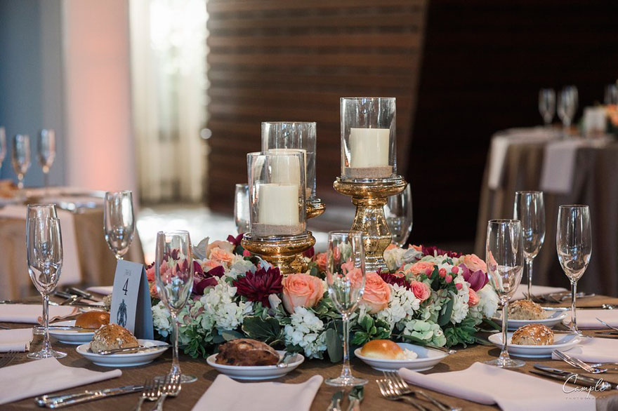Floral and Candle Centerpiece at Wedding