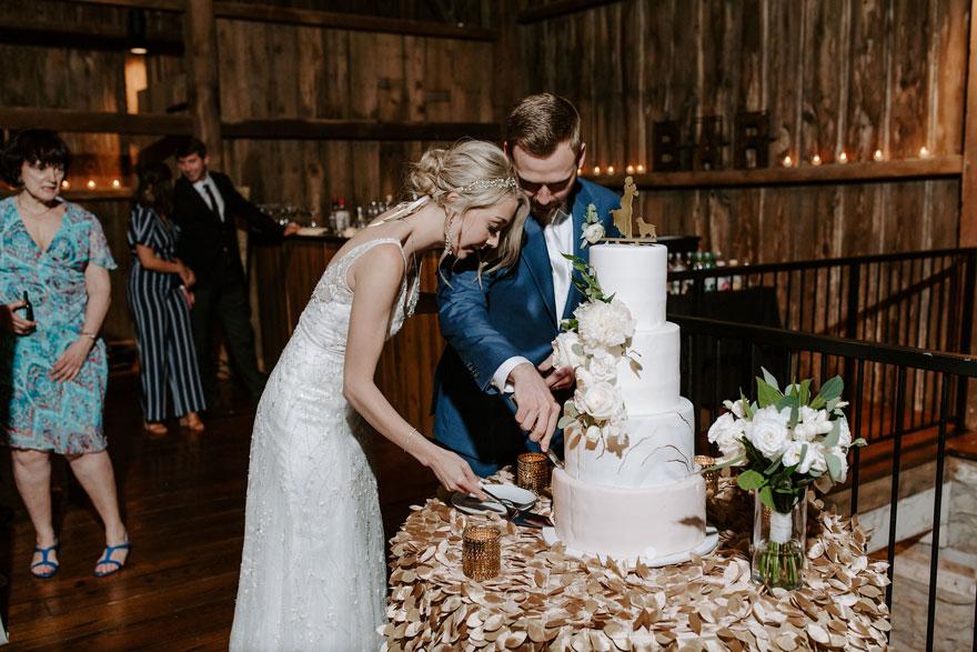 Bride and Groom Cut Cake at The Farm at Eagles Ridge