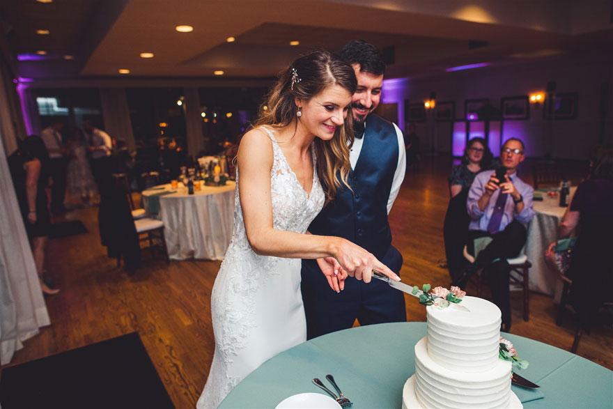 Bride and Groom Cut Cake at Radnor Hunt Wedding